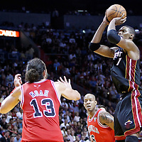 06 March 2011: Miami Heat power forward Chris Bosh (1) takes a jumpshot during the Chicago Bulls 87-86 victory over the Miami Heat at the AmericanAirlines Arena, Miami, Florida, USA.