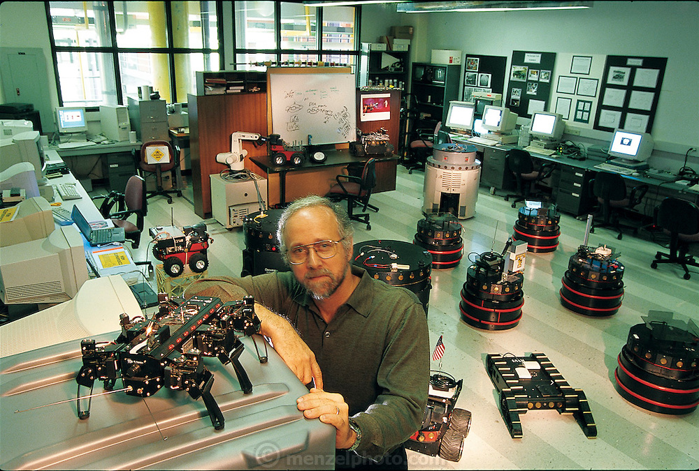 """Surrounded by the robots used in his Georgia Institute of Technology laboratory, computer scientist Ronald C. Arkin specializes in behavior-based robots, he's written a textbook with that name. Concerned more with software than hardware, he buys robots from companies and modifies their behavior, increasing their capacities. But outside such places, what Arkin calls """"the physical situatedness"""" of the robot is """"absolutely crucial"""" to its ability to act and react appropriately. Like many of his colleagues, he has been inspired by the way insects and other nonhuman life forms have adapted to their environment. From the book Robo sapiens: Evolution of a New Species, page 153."""