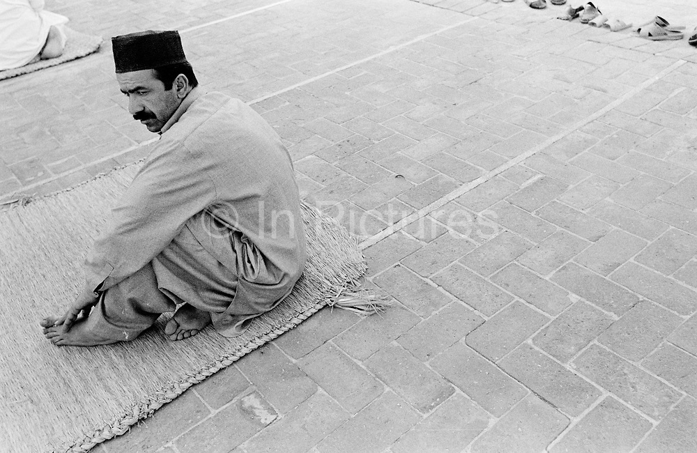 Man at an Ahmadiyya mosque, Rabwah, Pakistan. Also known as Qadiani's The Ahmadiyyas are the followers of Hazrat Mirza Ghulam Ahmad Qadiani (1835-1908). According to his followers, he was the  founder of the Ahmadiyya Muslim Jama'at and The Promised Messiah and Imam Mahdi. The Ahmadiyya (Qadiani) movement in Islam is a religious organisation with more than 30 million members worldwide. Ahmadiyyas are now banned from calling themselves Muslim in Pakistan and suffer terrible discrimination under anti-blasphemy laws and are regularly murdered for their faith.
