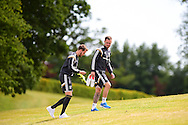 Aaron Ramsey ® and Chris Gunter of Wales arrive for  Wales football team training at the Vale Resort, Hensol near Cardiff, South Wales on Monday 8th June 2015. The Wales team are preparing for their forthcoming Euro 2016 qualifying match against Belgium.<br /> pic by Andrew Orchard, Andrew Orchard sports photography.