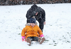 Snow in West Lothian, 10 February 2020<br /> <br /> Following on from the destruction of Storm Ciara, heavy snow started to fall in West Lothian this afternoon<br /> <br /> Pictured: A young girl has fun on her sledge helped by her mum<br /> <br /> Alex Todd | Edinburgh Elite media