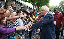 © Licensed to London News Pictures. 29/08/2011. London, UK. London Mayor Boris Johnson visits the Notting Hill Carnival on Bank Holiday Monday and is greeted enthusiastically by Londoners and Carnivalists alike. Notting Hill Carnival director Ancil Barclay, right. Photo credit: Bettina Strenske/LNP