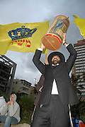 """Israel, Tel Aviv, Chabad Lubavitch Hasidim protesting the annual gay pride parade with a """"Salvation"""" parade including Torah scrolls and flags proclaiming the  messiah"""
