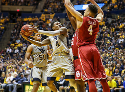 Jan 6, 2018; Morgantown, WV, USA; West Virginia Mountaineers guard Daxter Miles Jr. (4) shoots over Oklahoma Sooners center Jamuni McNeace (4) during the second half at WVU Coliseum. Mandatory Credit: Ben Queen-USA TODAY Sports