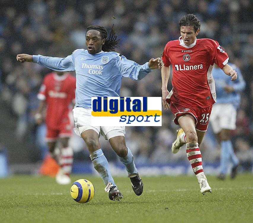 Photo: Aidan Ellis.<br /> Manchester City v Charlton Athletic. The Barclays Premiership. 12/02/2006.<br /> City's Kiki Musampa ngets away from Charlton's Alexi Smertin