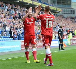 Cardiff City's Aron Gunnarsson celebrates his goal with Cardiff City's Anthony Pilkington - Photo mandatory by-line: Alex James/JMP - Mobile: 07966 386802 30/08/2014 - SPORT - FOOTBALL - Cardiff - Cardiff City stadium - Cardiff City  v Norwich City - Barclays Premier League