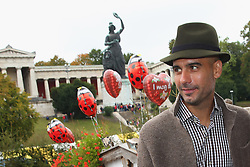 06.10.2013, Kaefers Wiesenschaenke, Muenchen, GER, der FC Bayern Muenchen beim Oktoberfest, im Bild Pep Guardiola, head coach of Bayern Muenchen looks on in front of the ensemble of the Bavaria statue, a monumental bronze sand-cast 19th-century statue and the Hall of Fame (Ruhmeshalle). The Bavaria is the female personification of the Bavarian homeland and by extension its strength and glory // during the Oktoberfest 2013 beer festival at Kaefers Wiesenschaenke in Munich, Germany on 2013/10/06. EXPA Pictures © 2013, PhotoCredit: EXPA/ Eibner/ Eckhard Eibner<br /> <br /> ***** ATTENTION - OUT OF GER *****