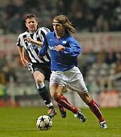 Photo. Jed Wee.<br />Newcastle United v Vålerenga, UEFA Cup 3rd Round, St. James' Park, Newcastle. 03/03/2004.<br />Valerenga's David Hanssen (R) leaves Newcastle's Michael Bridges in his wake.
