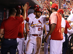 July 28, 2017 - St. Louis, MO, USA - The St. Louis Cardinals' Tommy Pham, middle, is congratulated by teammates after scoring on a sixth-inning single by Jedd Gyorko against the Arizona Diamondbacks at Busch Stadium in St. Louis on Friday, July 28, 2017. The Cards won, 1-0. (Credit Image: © Christian Gooden/TNS via ZUMA Wire)