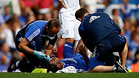 Photo: Richard Lane/Sportsbeat Images. <br />Chelsea v Birmingham. Barclay's Premiership. 12/08/2007. <br />Chelsea's Didier Drogba is treated while lieing injured with a cut to his head.