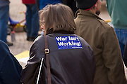 Peace activist with slogan on back