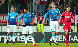 Per Mertesacker of Arsenal and teammates cut dejected figures after conceding a goal - Mandatory by-line: Robbie Stephenson/JMP - 23/11/2017 - FOOTBALL - RheinEnergieSTADION - Cologne,  - Cologne v Arsenal - UEFA Europa League Group H