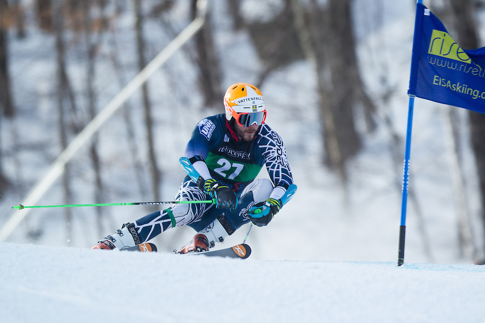 Coley Oliver of the University of New Hampshire, skis during the first run of the men's giant slalom at the Dartmouth Carnival at Dartmouth Skiway on February 7, 2014 in Lyme, NH. (Dustin Satloff/EISA)