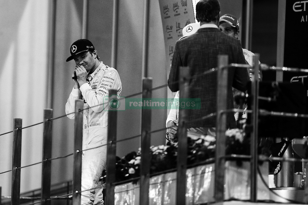 Rennen des Grand Prix von Abu Dhabi auf dem Yas Marina Circuit / 271116<br /> <br /> ***Abu Dhabi Formula One Grand Prix on November 27th, 2016 in Abu Dhabi, United Arab Emirates - Racing Day ***<br /> <br />  World Champion Nico Rosberg (GER) Mercedes AMG F1 celebrates on the podium.<br /> 27.11.2016. Formula 1 World Championship, Rd 21, Abu Dhabi Grand Prix, Yas Marina Circuit, Abu Dhabi, Race Day.