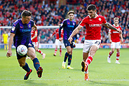 Barnsley midfielder Alex Mowatt (27) chips the ball into the box during the EFL Sky Bet League 1 match between Barnsley and Luton Town at Oakwell, Barnsley, England on 13 October 2018.
