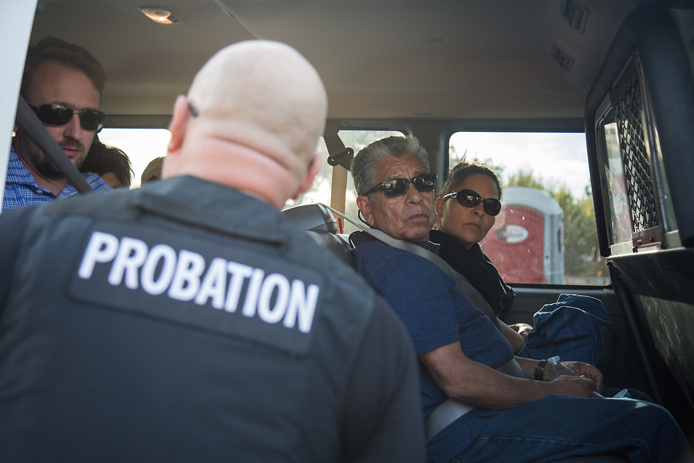 People suffered from Ventura Fire gets on the truck of Los Angeles County Probation Department to pick up their items from their house. On Saturday, December 10th, 2017 at Ventura, California. (Photo by Yuki Iwamura)