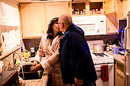Rev. Jaime Lee Sprague-Ballou, 55, left, kisses her husband David Ballou, 59, before he leaves for work in the morning at their home in Las Vegas, Nev., Tuesday, Dec. 5, 2017. Sprague-Ballou, who identifies as a transgender woman, is the lead pastor at Mary Magdalene Friends, United Church of Christ in Las Vegas. The church provides a safe environment for members of the LGBTQ community, including those seeking to belong to a church. Sprague-Ballou, with the help of her husband, also operates a drop-in center for the transgender community in Las Vegas called Transcending the Gender Box. The center holds a bi-monthly support group for those that have gone and are going through the transitioning process.