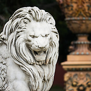A statue of a lion in the gardens at Dolmabahçe Palace. Dolmabahçe Palace, on the banks of the Bosphorus Strait, was the administrative center of the Ottoman Empire from 1856 to 1887 and 1909 to 1922. Built and decorated in the Ottoman Baroque style, it stretches along a section of the European coast of the Bosphorus Strait in central Istanbul.