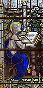 Stained glass window detail Blessed Virgin Mary child learning, Aldeburgh church, Suffolk, England, UK c 1929 A K Nicholson