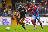Sean Scannell of Bradford City (7) and Kyle Wootton of Scunthorpe United (29) in action during the EFL Sky Bet League 1 match between Scunthorpe United and Bradford City at Glanford Park, Scunthorpe, England on 27 April 2019.