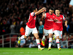 Arsenal's Alex Oxlade-Chamberlain celebrates his wonder strike with fellow young team mates Arsenal's Francis Coquelin and Arsenal's Nico Yennaris - Photo mandatory by-line: Joe Meredith/JMP  - Tel: Mobile:07966 386802 26/09/2012 - Arsenal v Coventry City  - SPORT - FOOTBALL - Capital One League Cup -  London  - Emirates Stadium