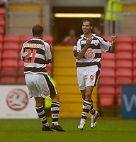 Photo: Jed Wee.<br />Darlington v Swindon Town. Coca Cola League 2. 19/08/2006.<br /><br />Darlington's Tano Giallanza (R) scores on the stroke of half time to get them back in the game.