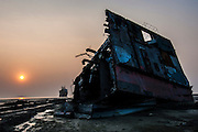 A chunk of ship lies on the strand at shipbreaking yard, Chittagong, Bangladesh, December 2006.<br />