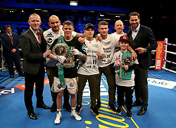 Charlie Edwards celebrates beating Angel Moreno in their World Boxing Council World Flyweight Title bout, with promoter Eddie Hearn (right) at the Copper Box Arena, London.
