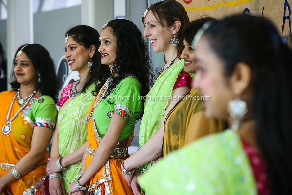 """(4/12/14, SUDBURY, MA) Dancers pose for a photo during the 1st annual """"Celebrate Asia!"""" festival at Lincoln-Sudbury Regional High School on Saturday. Daily News and Wicked Local Photo/Dan Holmes"""