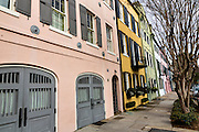Colorful pastel building facades on Rainbow Row along East Bay Street in historic Charleston, SC.