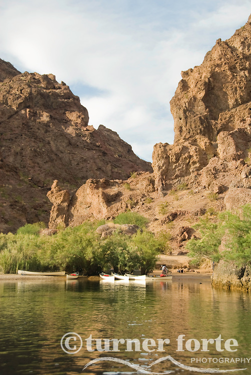 Canoers rest on the shore of The Black Canyon, Nevada.