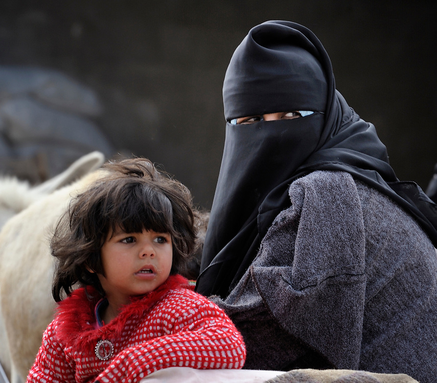 A mother and daughter in the market of the Nuseirat refugee camp in the middle of the Gaza strip. .