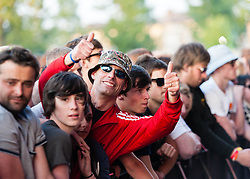 "© Licensed to London News Pictures. 07/06/2013. London, UK.   Fans cheer as The Stone Roses perform live at Finsbury Park. The Stone Roses are an English rock band formed in Manchester in 1983, consisting of vocalist Ian Brown, guitarist John Squire, bassist Gary ""Mani"" Mounfield, and drummer Alan ""Reni"" Wren. They were one of the pioneering groups of the Madchester movement that was active during the late 1980s and early 1990s.   Photo credit : Richard Isaac/LNP"