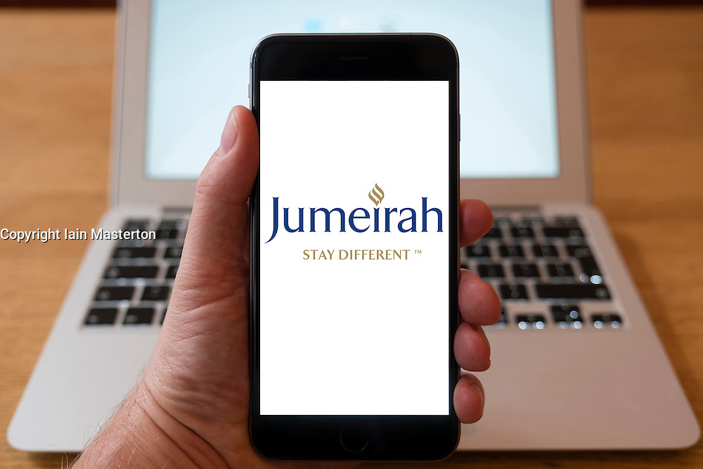 Using iPhone smartphone to display logo of Jumeirah hotel and resort group
