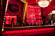 Red bar at KOKO, a nightclub in a former theatre in Camden Town, London, UK, at the bottom of Camden High Street close to Mornington Crescent. Until 2004 it was called the Camden Palace. The building is considered to have some architectural significance and is a Grade II listed building. Now it is a live music venue of great reputation with it's many leveled tiered shape it provides a large but intimate space.