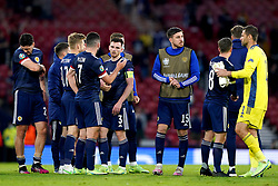 Scotland players look dejected after the UEFA Euro 2020 Group D match at Hampden Park, Glasgow. Picture date: Tuesday June 22, 2021.