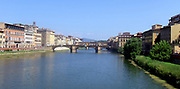 Image of the Arno River and it's surroundings in Florence, Italy. The river originates in Mount Falterona and runs through Florence, Empoli and Pisa. Ancient buildings and classical architecture line the river in Florence.