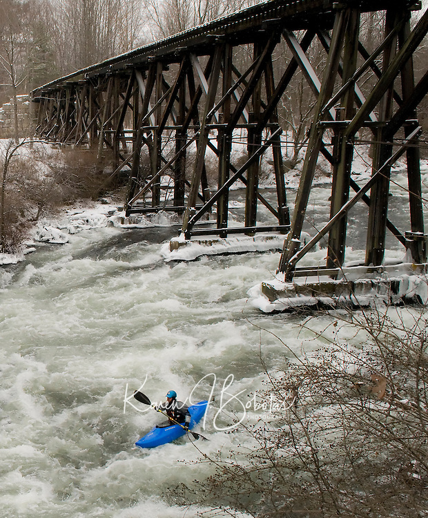 The annual New Years Kayak run down the Winnipesaukee River at Trestle View Park in Franklin, NH as part of the First Day Franklin event.  Karen Bobotas Photographer.