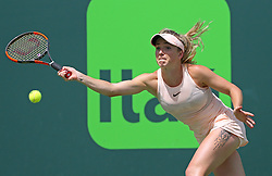March 28, 2018 - Key Biscayne, FL, USA - Elina Svitolina, of Latvia, returns a shot against Jelena Ostapenko, of Ukraine, during their match at Miami Open tennis tournament on Wednesday, March 28, 2018 at Crandon Park Tennis Center in Key Biscayne, Fla. (Credit Image: © David Santiago/TNS via ZUMA Wire)