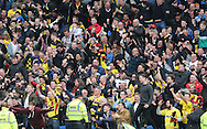 Watford fans celebrate at the final whistle during the Sky Bet Championship match between Brighton and Hove Albion and Watford at the American Express Community Stadium, Brighton and Hove, England on 25 April 2015.