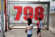 Large red numbers at the entrance of 798. 798 Art Zone or Dashanzi Art District, is a part of Dashanzi in the Chaoyang District of Beijing, China that houses a thriving artistic community, among 50-year old decommissioned military factory buildings of unique architectural style. The area is often called the 798 Art District or Factory 798 although technically, Factory #798 is only one of several structures within a complex formerly known as Joint Factory 718.