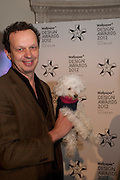 TOM DIXON WITH HIS DOG, Wallpaper Design Awards 2012. 10 Trinity Square<br /> London,  11 January 2011.