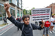 """Demonstrators chant """"Black Lives Matter"""" on Wednesday, June 3, 2020, at the US Embassy in south London, during a protest over the death of George Floyd, who died on May 25 after he was restrained by Minneapolis police in the United States. (Photo/ Vudi Xhymshiti)"""