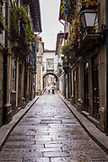 Typical street scene of narrow alleyway in quaint town of Guimaraes in Northern Portugal