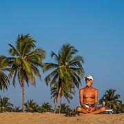 A man enjoys the afternoon sun on south Goa's Agonda beach
