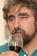 Antoine Gonzalez, the chief winemaker tasting a glass of red wine - Chateau Belgrave, Haut-Medoc, Grand Crus Classee 1855