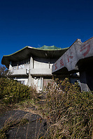 """Kurotake Drive-in Haikyo -  The Kurotake Drive-in is found along the Izu Skyline Drive.  Although there are no """"Do Not Enter"""" signs there are chains at the parking lot, and the windows have been cemented in. Haikyo simply means ruins in Japanese and at the same time refers to the hobby known as urban exploration or URBEX popular in industrialzed societies. Haikyo enthusiasts visit abandoned towns, houses, hospitals, schools, industrial sites, theme parks or other forgotten or abandoned places."""