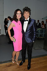 RONNIW WOOD and his wife SALLY HUMPHREYS at the GQ Men Of The Year 2014 Awards in association with Hugo Boss held at The Royal Opera House, London on 2nd September 2014.