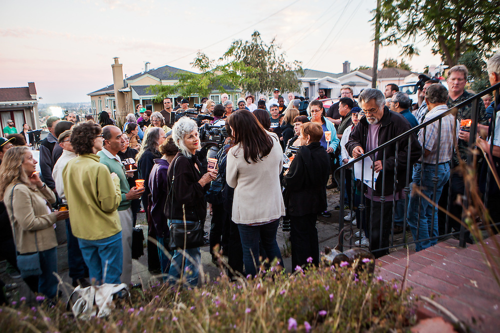 Maxwell Park residents hold a candlelight vigil on Thursday July 25, 2013 for neighbor Judy Salamon. Salamon was shot and killed a day earlier while driving in the neighborhood, apparently a random shooting victim.