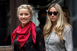 © Licensed to London News Pictures. 15/07/2020. LONDON, UK.  Amber Heard (L), ex-wife of Johnny Depp, Hollywood actor, arrives at the High Court to attend day 7 of Mr Depp's libel case.  Mr Depp is suing The Sun newspaper's publisher News Group Newspaper, as well as executive editor Dan Wootton, for calling him a 'wife beater' in 2018. Mr Depp also that claims allegations of violence against Heard are untrue.  The case continues.  Photo credit: Stephen Chung/LNP